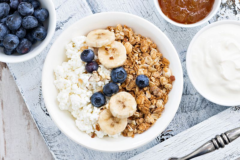 Healthy delicious breakfast with cottage cheese, muesli