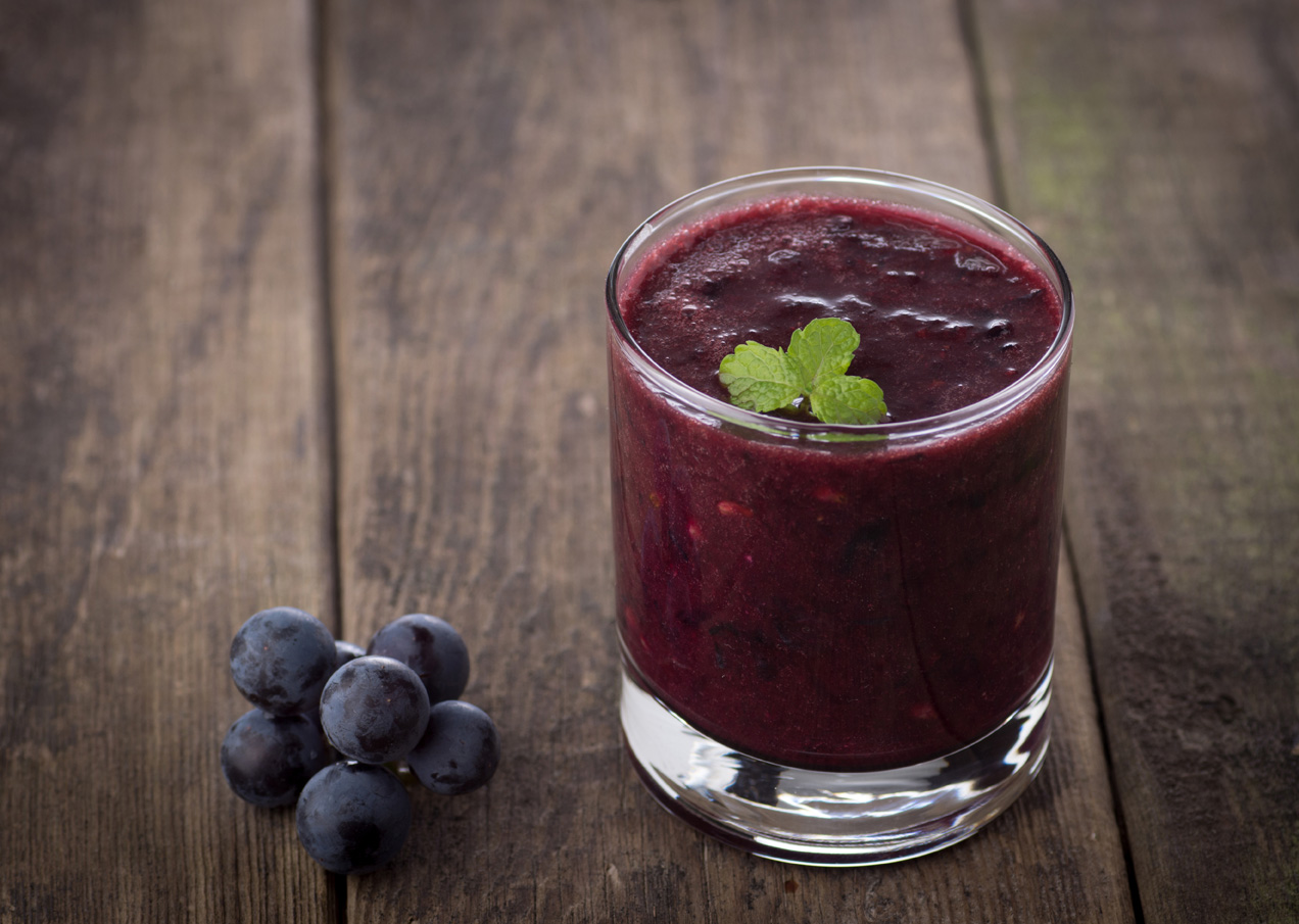 Glass of Grape Juice smoothie on wooden